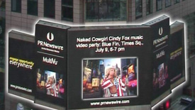 Naked Cowgirl on Reuters Billboard